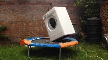 Washing Machine With A Brick Spinning Bounces On Trampoline