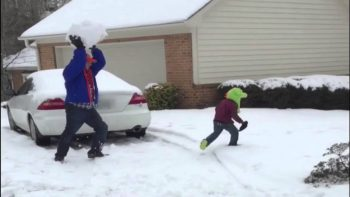 Dad Throws Giant Snowball At His Kid