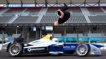 Daredevil Backflips Over Speeding Formula Race Car