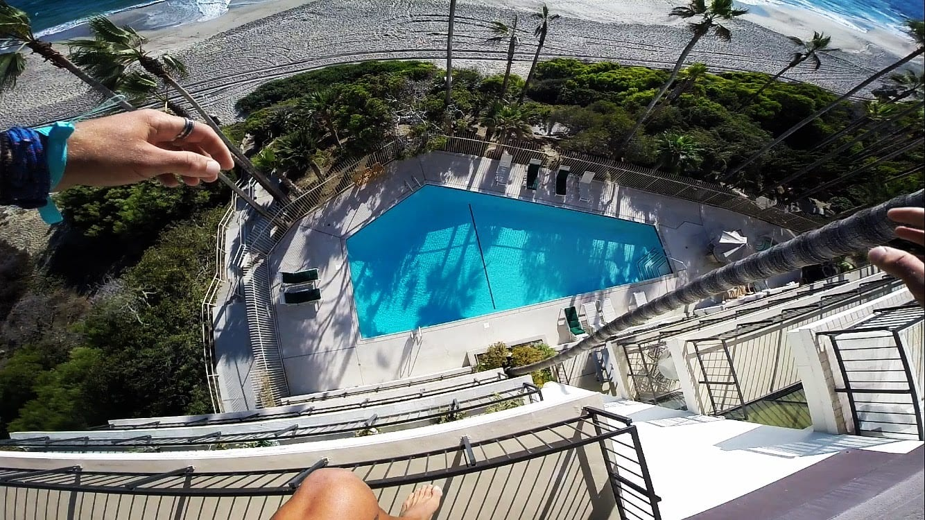 Crazy Dude Jumps From Hotel Roof Into Pool