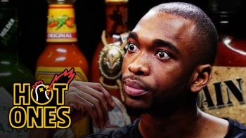 Jay Pharoah Has a Staring Contest While Eating Spicy Wings