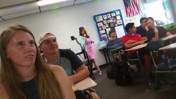 Teacher Performs Super Awkward School Themed Pop Music Medley On First Day