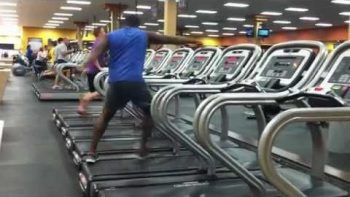 Man Dances On Treadmill At The Gym