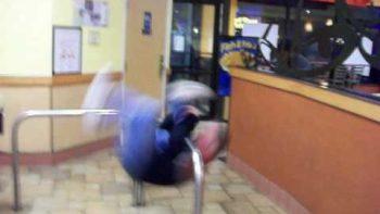 Elderly Man Spins On Handrail At Taco Bell
