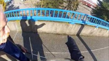 Moped Rider Helps Blind Man Walking In Street