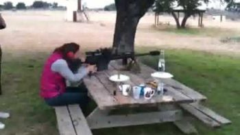 Woman Clears Picnic Table Firing 50 Caliber On It