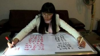 Chinese Woman Writes With Two Hands Simultaneously