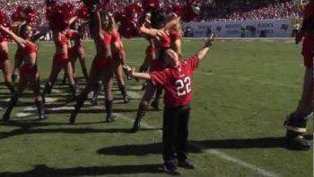 Boy Dances With Tampa Bay Buccaneers Cheerleaders