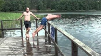 Guy Running On Dock Slides Into Guardrail, Flips Over Into Lake Fail