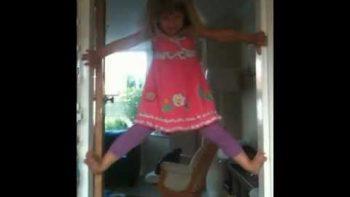 """Little Girl Climbs Door Post: """"I Can Do It!"""""""