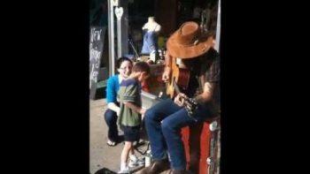 Blind Autistic Boy Enjoys Street Guitar Performance