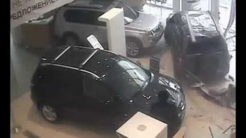 Angry Patron Drives Car Through Glass Into Dealer Showroom
