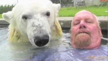 Man Plays, Swims With Pet Polar Bear