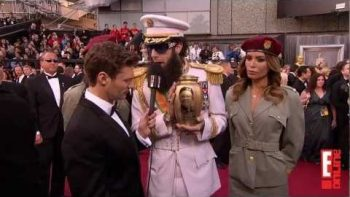 Sacha Baron Cohen The Dictator Spills Kim Jong Il's 'Ashes' On Ryan Seacrest