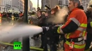 Firefighters Spray Police In Brussels Protest