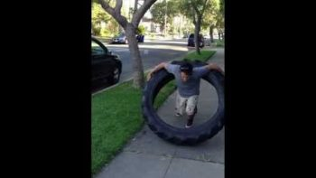 Man Hula-Hoops With 100 Pound Monster Truck Tire