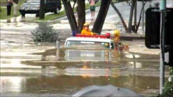 Fire Truck Drives Through Australian Flooded Road