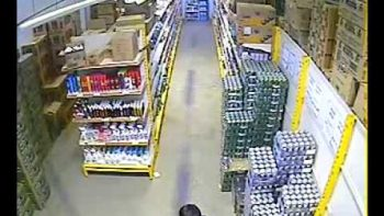 Security Camera: Woman Hides Case Of Drinks Under Her Skirt