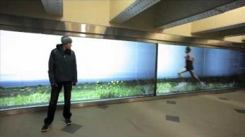 Olympic Runner Ryan Hall Running Video Wall In NYC Subway Station