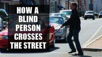 Blind Man Crosses Busy Street In Manhattan