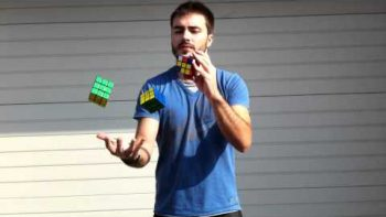 Prodigy Juggles And Solves Rubik's Cubes