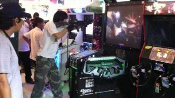 Asian Gamer Takes Arcade Gun Game Very Seriously
