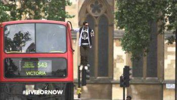 British Magician Dynamo Levitates On Side Of Double Decker Bus
