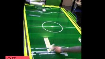 High-Speed Intelligent Air-Hockey Playing Robot