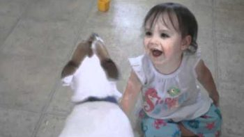 Baby And Dog Love To Pop Bubbles