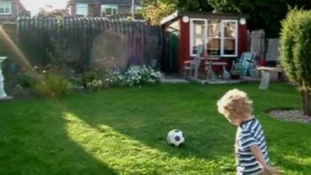 Baby Boy Kicks Soccer Ball, Breaks Fence And Neighbor's Roof