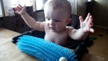 Baby Scared After Touching Toy