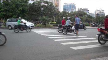 Crossing Busy Street In Vietnam