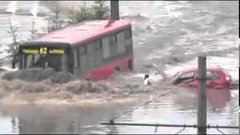 Bus Drives Through Flooded Road