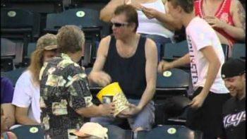 Fan Catches Foul Ball In Popcorn Bucket