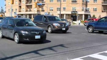 Man Conducts Toronto Traffic After Traffic Light Malfunction