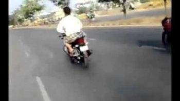 Little Indian Girl Driving Motorcycle With Dad