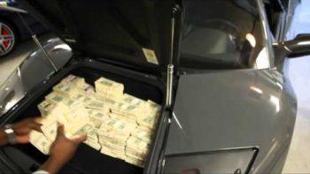 50 Cent Fills Lamborghini With Money Stacks