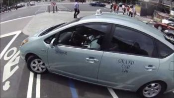 Cab Taking Illegal U-Turn Almost Hits Biker, Cop Immediately Pulls Cab Over