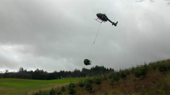 Christmas Tree Hauling With A Helicopter