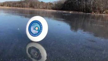 Frisbee Keeps Rolling Across A Frozen Lake On A Windy Day