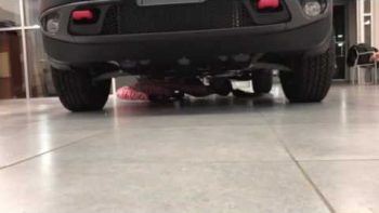 Woman Limbos Under Car