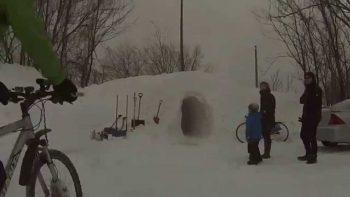Riding Bikes Through Giant Snow Tunnel